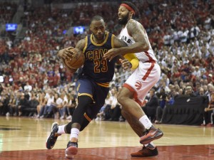 Cavaliers forward LeBron James drives to the basket as Toronto forward James Johnson defends Friday night during the second half of Game 6 of the NBA Eastern Conference finals at Toronto.