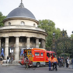 A fire truck is parked at the entrance to Parc Monceau in Paris on Saturday, after lightning struck eight children and three adults at a children's birthday party.