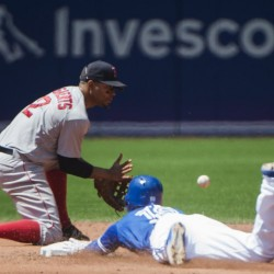 Toronto second baseman Darwin Barney slides safe past Boston shortstop Xander Bogaerts after hitting a double in the third inning of Saturday's game in Toronto.