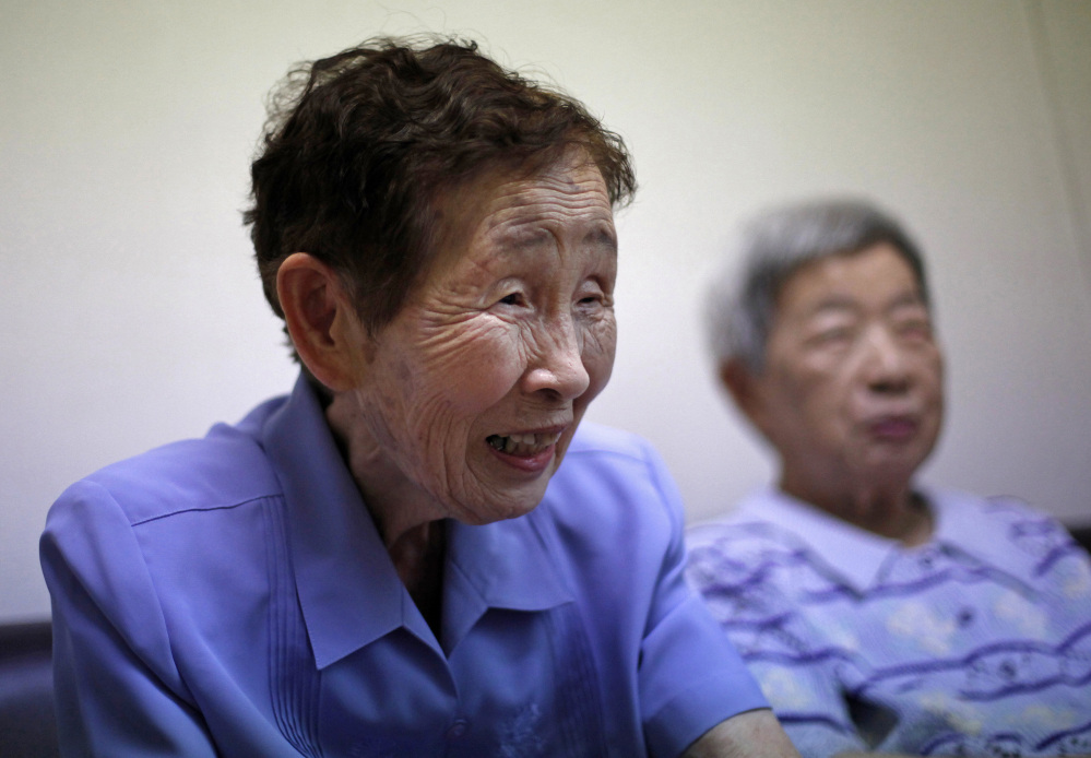 "Bomb survivor Kimie Miyamoto, 89, left, says ""The world paid attention to what happened"" in Hiroshima because President Obama visited. ""But you never know if it will make a difference ... ."" At right is another bomb survivor, 89-year-old Michiko Kimoto."