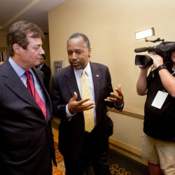 Donald Trump strategist Paul Manafort, left, chats with former presidential candidate Ben Carson in Hollywood, Fla. Trump's penchant for encouraging rivalries and pitting even those closest to him against each other is roiling his Republican presidential campaign as he plunges into the general election. The tensions boiled over last week with the abrupt ouster of political director Rick Wiley, who left the campaign after just six weeks.