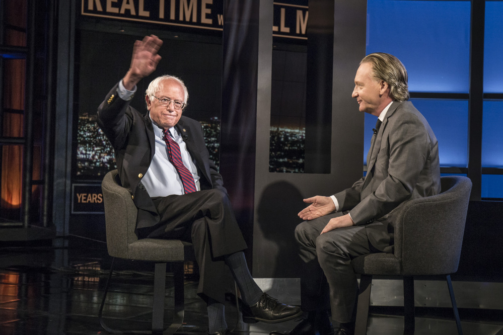 Democratic presidential candidate Sen. Bernie Sanders, I-Vt., speaks with host Bill Maher during an interview on