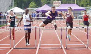 Paolo DeMarco, center, of  Deering, surges ahead in the 300-meter hurdles during the SMAA track and field championships at Thornton Academy on Saturday.  Jill Brady/Staff Photographer