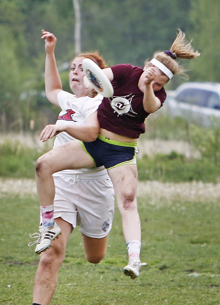 Lily Black of Cumberland makes a catch with pressure from Bridget Bailey of Fryeburg Academy during high school Ultimate state championships at Wainwright Sports Complex.  Jill Brady/Staff Photographer