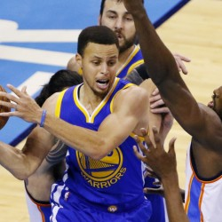 Warriors guard Stephen Curry looks to pass as Oklahoma City forward Serge Ibaka defends during Game 6 of the Western Conference finals Saturday night in Oklahoma City. Golden State overcame an eight-point deficit in the fourth quarter and tied the series with a 108-101 win.