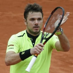 Stan Wawrinka celebrates winning the fourth-round match against Viktor Troicki at the French Open on Sunday in Paris.