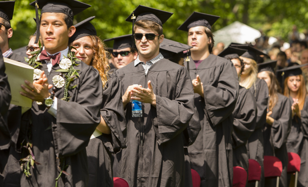 Bates College graduates applaud during the commencement ceremony Sunday.