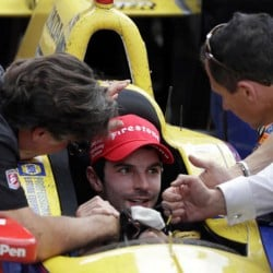 Alexander Rossi, center, celebrates with car owner Michael Andretti, left, after winning the 100th running of the Indy 500 on Sunday.