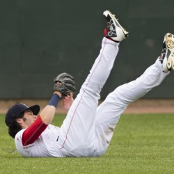 Sea Dogs outfielder Andrew Benintendi rolls over after making a shoestring catch in the second inning of Portland's 6-3 loss to Hartford on Sunday at Hadlock Field.