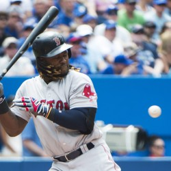 Red Sox designated hitter Hanley Ramirez is hit by a pitch with the bases loaded in the sixth inning against the Toronto Blue Jays on Sunday in Toronto. Boston scored twice in the sixth to take a one-run lead and twice in the 11th to win 5-3.