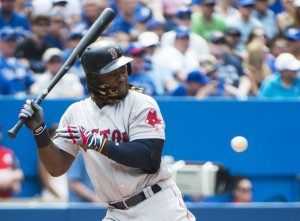 Red Sox designated hitter Hanley Ramirez is hit by a pitch with the bases loaded in the sixth inning against the Blue Jays on Sunday in Toronto. Boston scored twice in the sixth to tie it and twice in the 11th to win, 5-3.