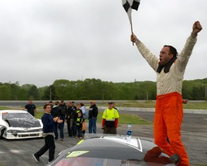 Chris Thorne of Sidney celebrates Sunday after winning the Coastal 200 at Wiscasset Speedway. Thorne, a three-time track champion, earned $3,525 for his victory.
