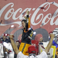 Martin Truex Jr. celebrates Sunday night after winning the Coca-Cola 600 at Charlotte Motor Speedway. Truex started from the pole and led a record 392 laps in the 400-lap event.