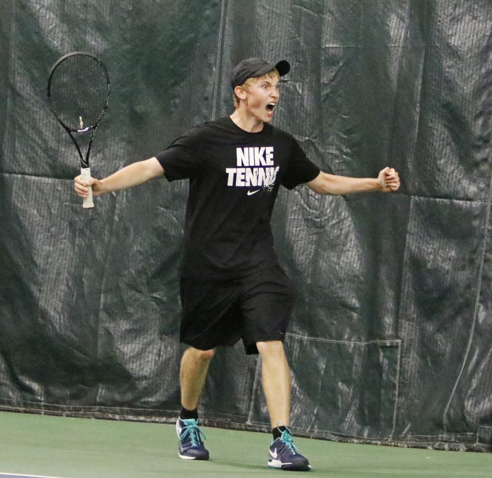 Mt. Ararat's Nick Mathieu celebrates after beating Dariy Vykhodtsev of Thornton Academy 6-4, 4-6, 6-2 to win the boys' singles tennis tittle on Monday at the Racket and Fitness Center.