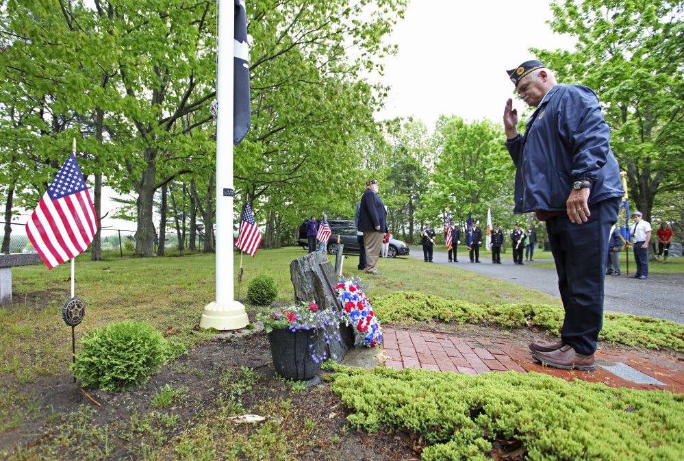 Commander of Scarborough American Legion Post 76 Phil Ceaser stands at attention after laying a memorial wreath at Black Point Ceremony during Memorial Day services in Scarborough.