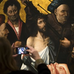 """The Passion"" triptych painting is in a new Madrid exhibit featuring works by Dutch artist Hieronymus Bosch."
