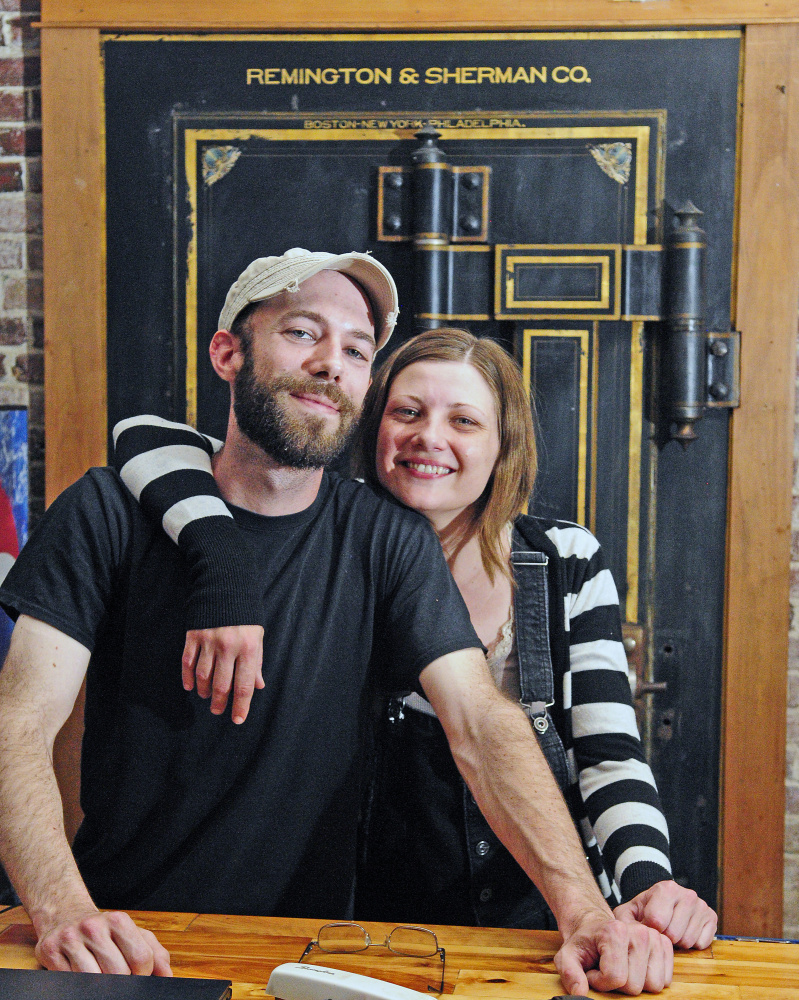 Buddy Iaciofano, left, and Becky Havens pose in front of the large safe that houses a walk-in cooler in the former Hattie's Chowder House on Tuesday May in Hallowell. They plan to reopen as Buddy's Diner in the space that used to be a bank branch on the corner of Water and Winthrop streets.