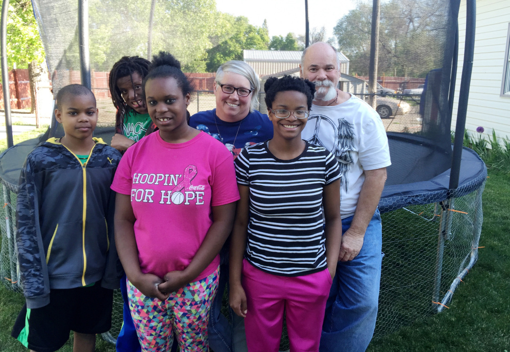 Shelly and Tim McDaniel, back row, right, are seen with some of their adopted children. The family contains almost the entire black population of Dietrich, Idaho.