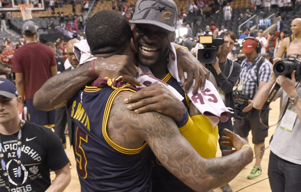LeBron James, right, and J.R. Smith celebrate after the Cavaliers beat the Toronto Raptors in Game 6 to win the Eastern Conference finals on Friday in Toronto. Cleveland has been on a roll since a team meeting on March 25.
