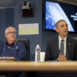 President Barack Obama visits the headquarters of the Federal Emergency Management Agency in Washington on Tuesday to receive a hurricane preparedness briefing. At left is FEMA Administrator Craig Fugate.
