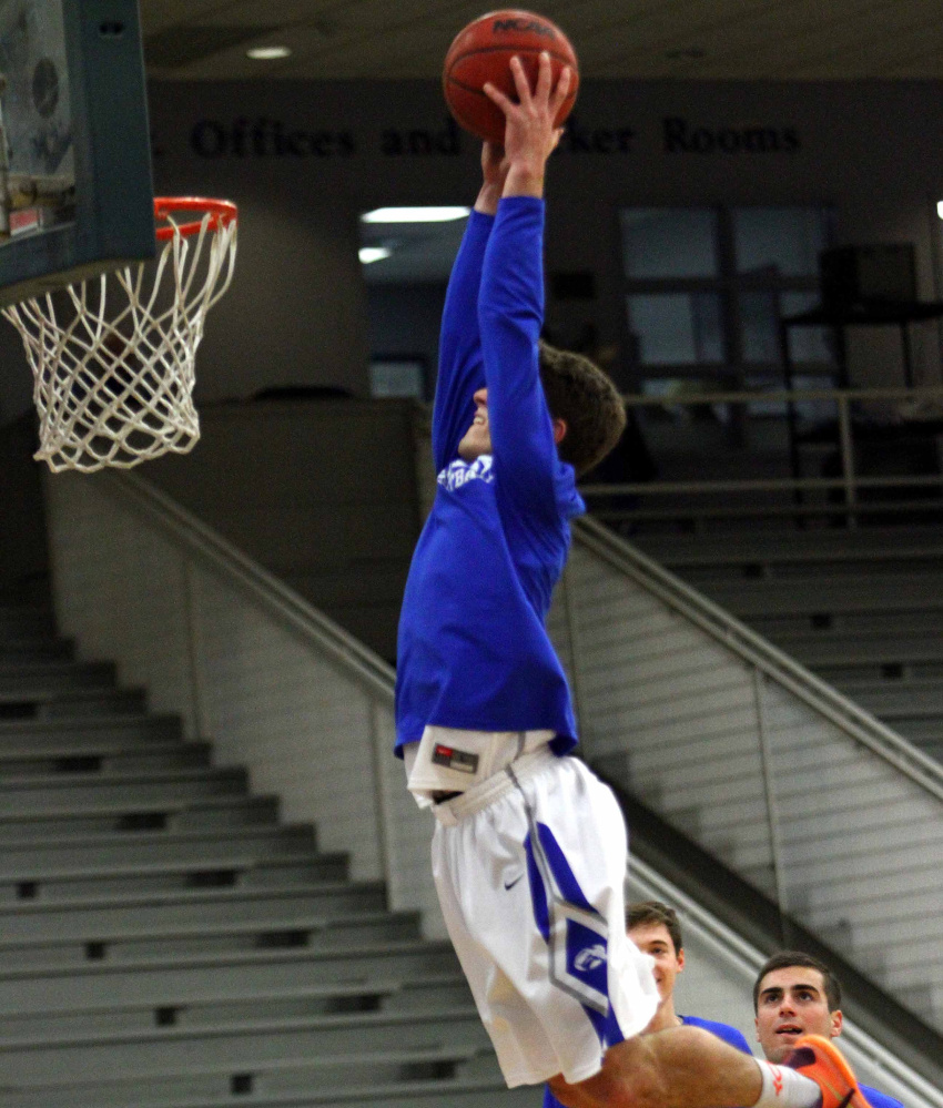 Contributed photo/Colby athletics   Colby College guard Pat Dickert goes up for a dunk prior to a game last season. Dickert, who is listed at 6-foot-2, made national headlines after he posted a video of himself dunking from behind a foul line.