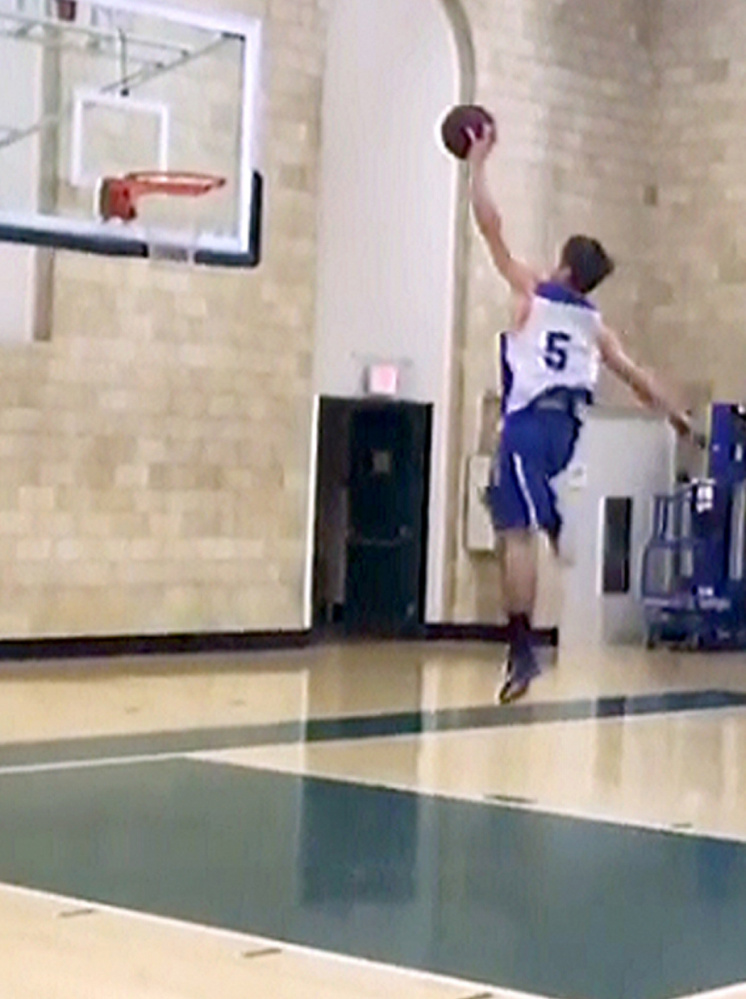 Colby College men's basketball player Pat Dickert posted a video of himself dunking from the foul line on Instagram last week and it has since gone viral, with over 200,000 views through Tuesday afternoon. Dickert is seen here in midflight in this screen grab from the Instagram video.