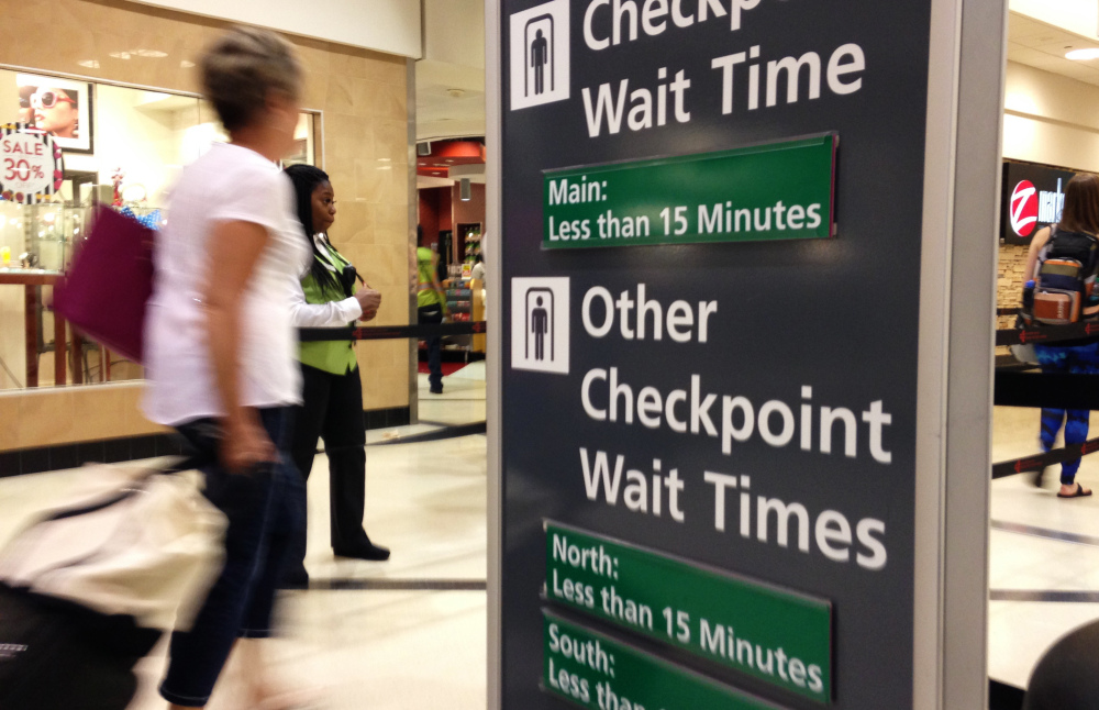 Airline passengers enter the main security checkpoint at Hartsfield-Jackson International Airport in Atlanta on Memorial Day.