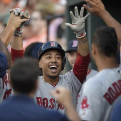 Boston's Mookie Betts celebrates his first-inning home run during the Red Sox's game with Baltimore on Tuesday.   The Associated Press