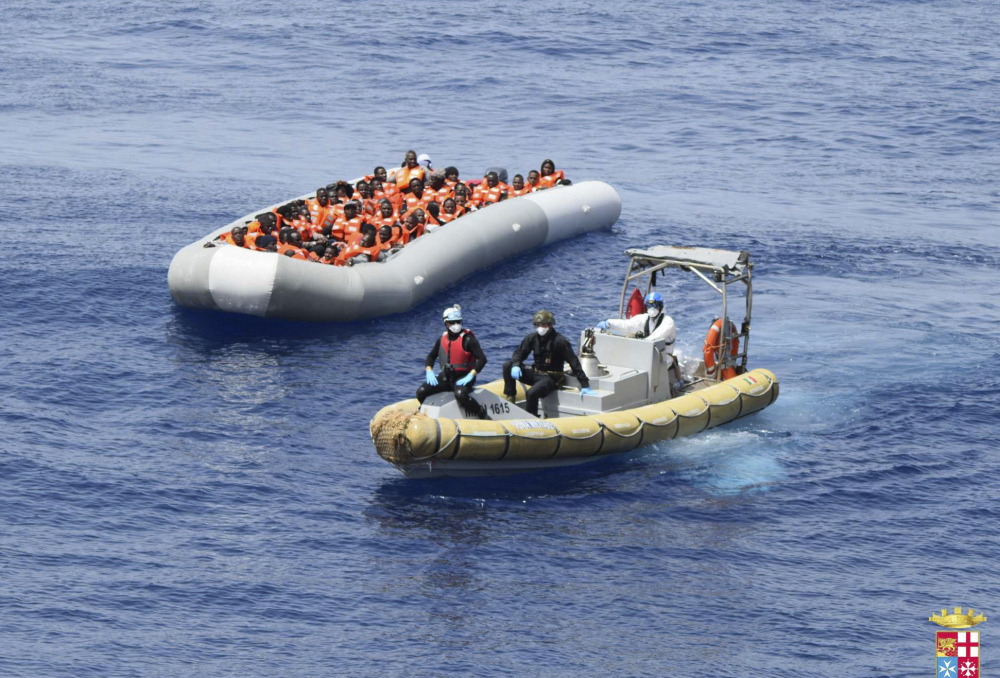 Migrants are shown being rescued in the Mediterranean Sea. The staggering death toll of at least 1,083 migrants over the past week occurred as barely seaworthy vessels loaded with passengers foundered and sank despite calm seas and sunny skies.