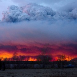 A wildfire moves toward the town of Anzac from Fort McMurray, Alberta., on Wednesday. Unseasonably hot temperatures combined with dry conditions have transformed the boreal forest in much of Alberta into a tinder box.  Jason Franson/The Canadian Press via AP
