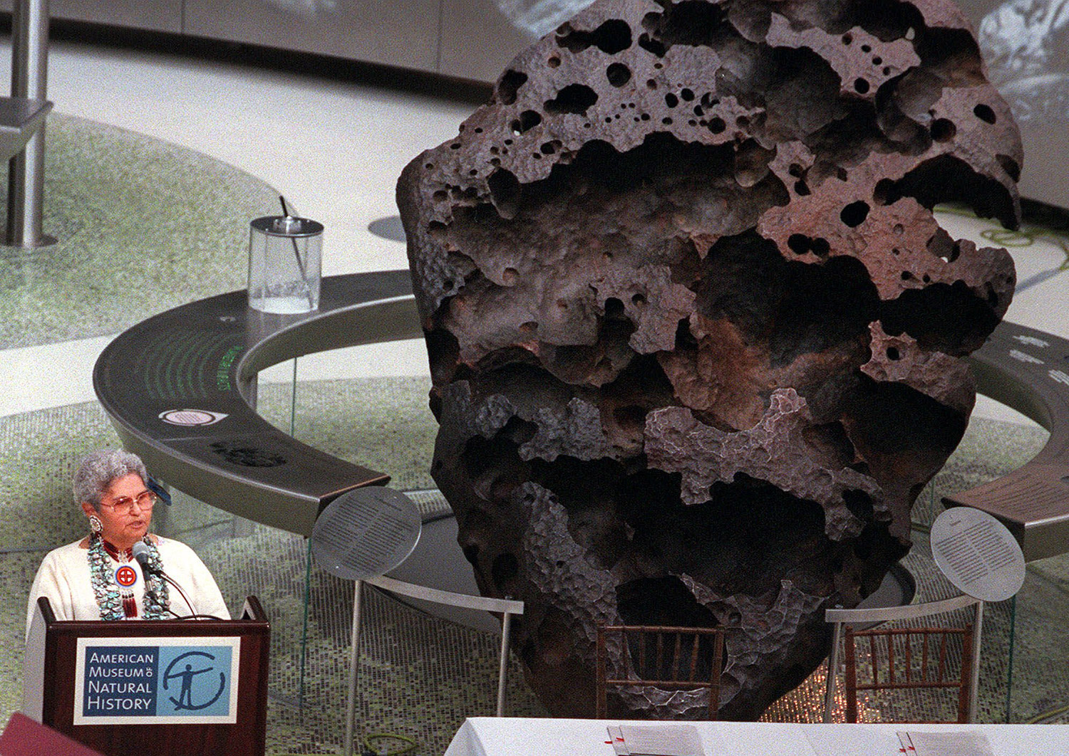 The 16-ton Willamette Meteorite is shown at New York's American Museum of Natural History. The 10,000-year-old meteorite was discovered near Portland, Oregon, nearly a century ago by a miner and purchased a few years later by a New York philanthropist who donated it to the museum, which agreed to share ownership with Oregon's Grand Ronde Tribal Council. Kathryn Harrison, chairwoman of the council at the time, is at left.