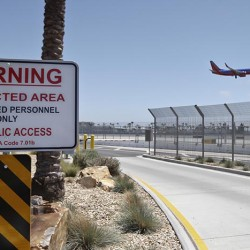 San Diego International Airport, where multiple layers of fencing topped with razor wire protect the airport grounds.