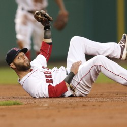Boston's Dustin Pedroia holds onto the ball as he rolls on the infield after making a catch during the Red Sox's 13-5 win over Oakland on Tuesday.   The Associated Press