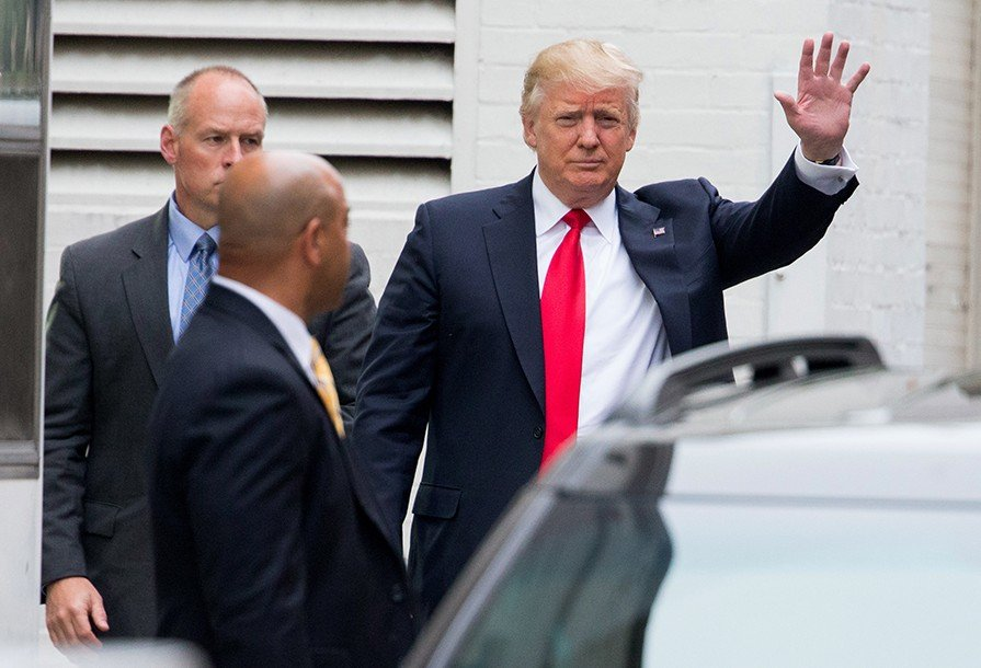 Republican presidential candidate Donald Trump waves as he arrives for a meeting with House Speaker Paul Ryan at the Republican National Committee Headquarters on Capitol Hill Thursday. The Associated Press