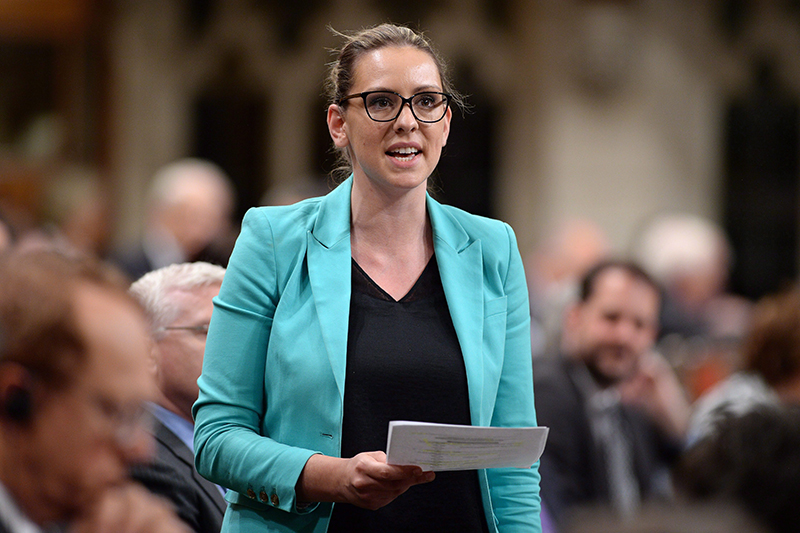 """In this Thursday, May 28, 2015 file photo, Ruth Ellen Brosseau asks a question during Question Period in the House of Commons in Ottawa, Ontario. Opposition lawmaker Ruth Ellen Brosseau said she was elbowed in the chest and had to leave the House of Commons chamber Wednesday after feeling overwhelmed. Canadian Prime Minister Justin Trudeau apologized """"unreservedly"""" for making physical contact with a female opposition member of Parliament who said Trudeau elbowed her in the chest as he waded through a group of mostly opposition lawmakers. (Sean Kilpatrick/The Canadian Press via AP) MANDATORY CREDIT"""