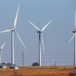 Wind turbines dot the landscape near Steele City, Neb. Wind turbines and solar panels accounted for more than two-thirds of all new electric generation capacity added to the national grid in 2015, according to a recent analysis by the U.S. Department of Energy. The Associated Press
