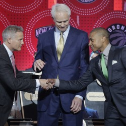 Philadelphia 76ers head coach Brett Brown, left, is congratulated by Boston Celtics guard Isaiah Thomas, right, and Los Angeles Lakers general manager Mitch Kupchak after the 76ers won the top draft pick Tuesday night.   The Associated Press