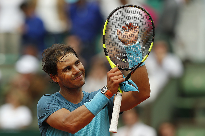 Rafael Nadal acknowledges cheering spectators after winning his second round match of the French Open.