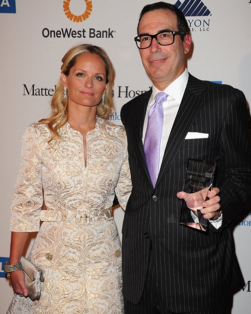Steven Mnuchin, seen here with his wife Heather Mnuchin in a 2013 photo, has been hired as national finance chairman for the Trump presidential campaign. Steven Mnuchin is  a New York investor with ties in Hollywood and Las Vegas but no previous political fundraising experience. Invision via AP