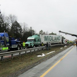 A tractor trailer crash closed lanes of the Maine Turnpike in both directions for several hours Monday morning at mile 105, two miles north of the West Gardiner exit. Photo courtesy of the Maine State Police