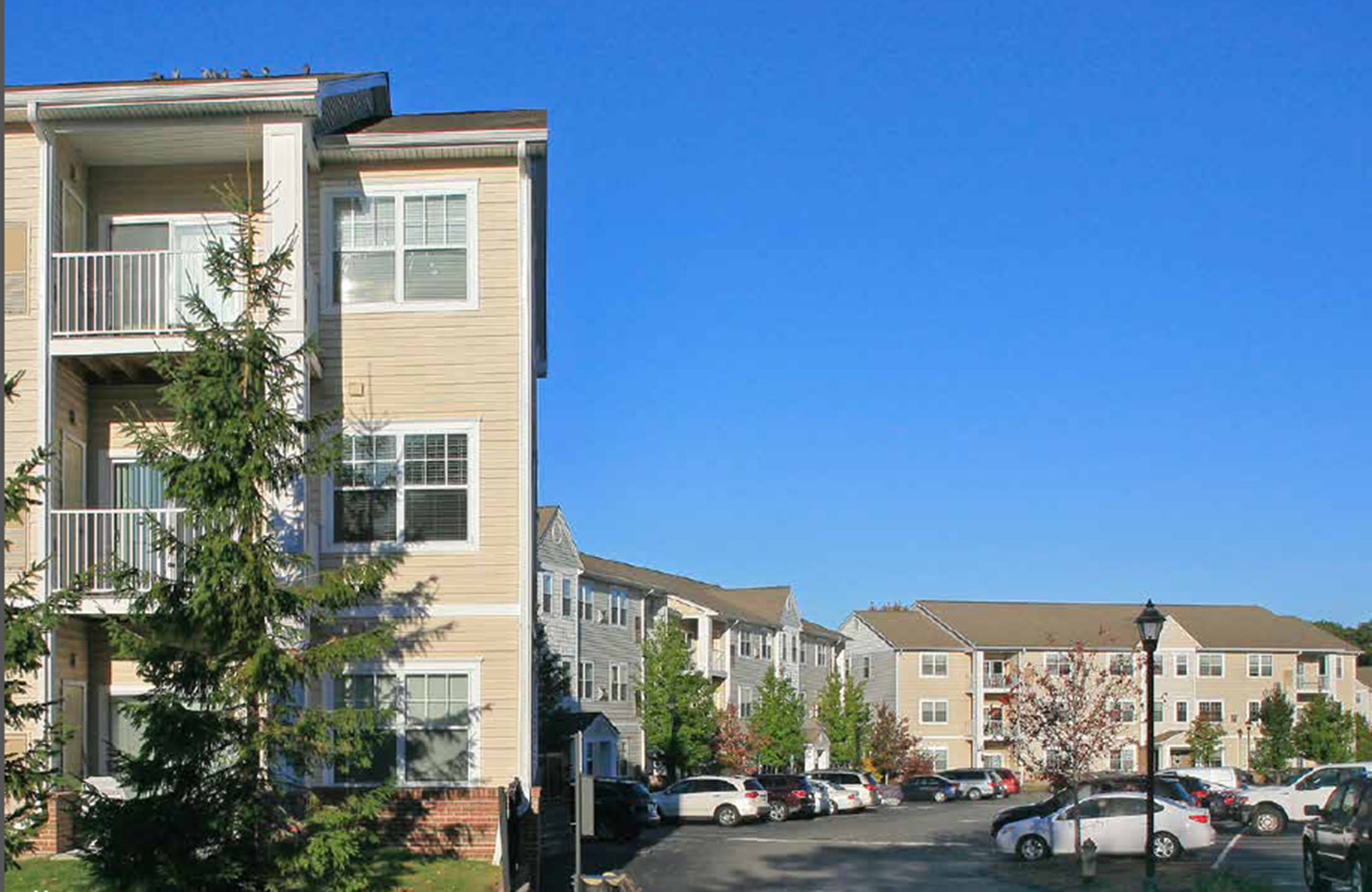 The Liberty Commons and Redbank Village apartment complexes in South Portland have been sold for $87.5 million to a Massachusetts investment firm.