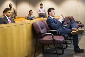 Former Cleveland Browns quarterback Johnny Manziel sits while his defense attorneys confer with the prosecution during his initial hearing, Thursday in Dallas. The Associated Press
