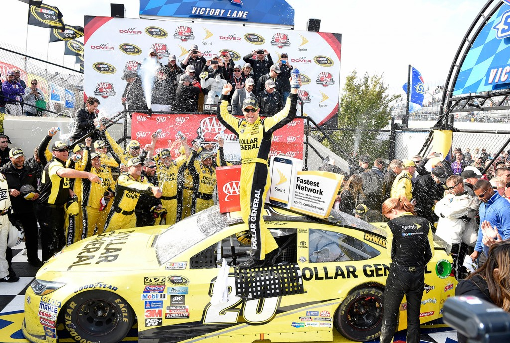 Matt Kenseth celebrates in Victory Lane after he won the NASCAR Sprint Cup series auto race, Sunday, May 15, 2016, at Dover International Speedway in Dover, Del. The Associated Press