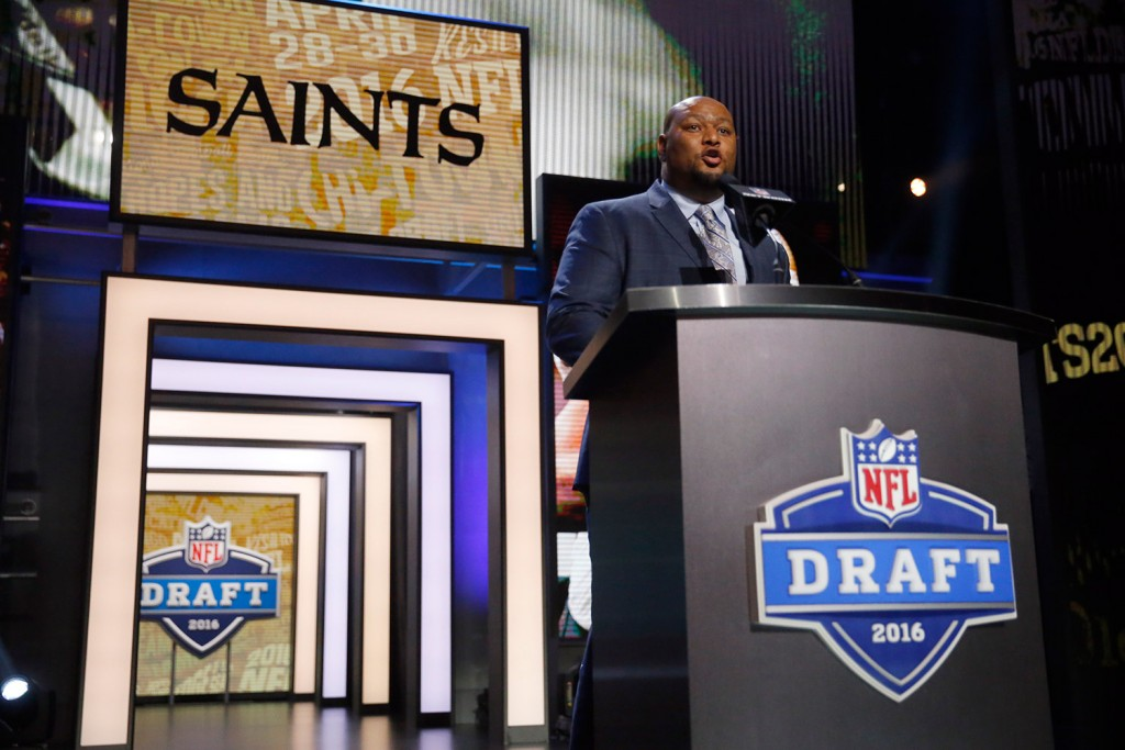 Former NFL player Deuce McAllister announces that the New Orleans Saints selects Ohio State's Michael Thomas as the 47th pick in the second round of the 2016 NFL football draft in Chicago. The Associated Press