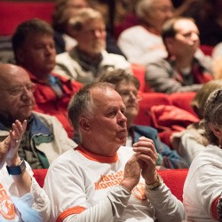 Supporters of a proposed North Woods national monument, Kate Rush, John and Susan Burgess, all of Newport, applaud as fellow supporters address National Park Service Director Jonathan B. Jarvis during a public comment meeting at the Collins Center for the Arts in Orono on Monday.