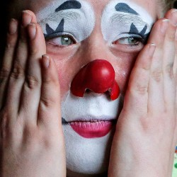 MAY 1: A circus clown cries as she watches the performing elephants in their final show for the Ringling Bros. and Barnum & Bailey Circus in Wilkes-Barre, Pennsylvania.