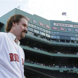 Former Boston Red Sox third baseman Wade Boggs is introduced before Wednesday's game at Fenway Park. The Associated Press