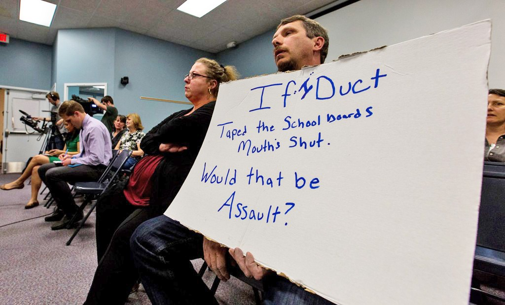 "Richard Bourgeois-Lang of Buxton holds a sign protesting the SAD 6 board's handling of the controversy surrounding Superintendent Frank Sherburne. Bourgeois-Lang and his wife, Melissa Bourgeois-Lang, left, created an outburst at the end of the meeting, after it was clear that Sherburne had not been fired. Richard Bourgeois-Lang slammed his fists on the table where the board sat, saying, ""You are not protecting our kids, you all need to go."""