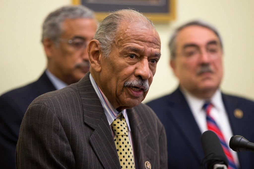 Rep. John Conyers, D-Mich., center, flanked by Rep. Bobby Scott, D-Va., left, and Rep. G.K.  Butterfield, D-N.C., speaks at a news conference Tuesday on Capitol Hill. Conyers and Scott were among the lawmakers who requested the report by the Government Accountability Office, which found deepening segregation of black and Hispanic students nationwide.