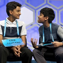 Nihar Janga, 11, , right, talks with Jairam Hathwar, 13, left, after another round where the two went head to head in a drawn out battle that ended in them being named co-champions.